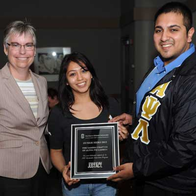 Jeanne Meyer (Bystander Intervention Education Committee Member/facilitator) with Patty Fernandez and Shak Abdullah of Alpha Psi Lambda, Gamma Chapter (Standout Organization Huskie Hero Award)