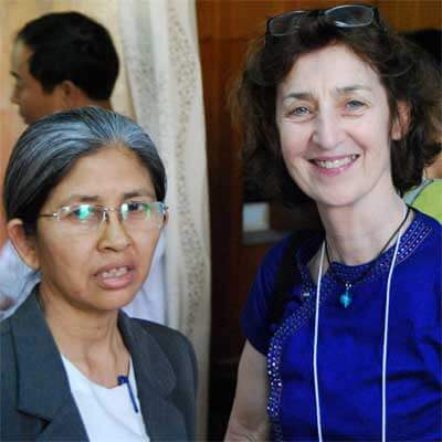 NIU's Catherine Raymond (right) with a faculty member from Myanmar.