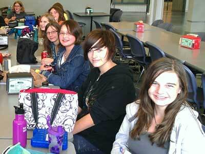 Creative Writing Day Camp students share stories over lunch at NIU's Grant Hall.