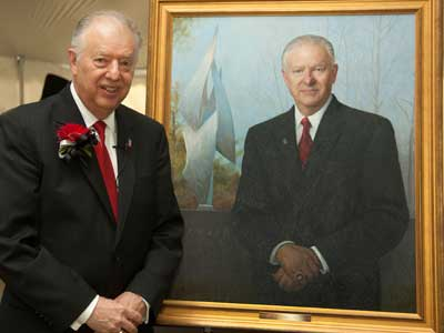 President Peters stands with his newly unveiled portrait.
