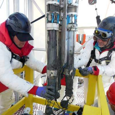 Ross Powell (left) and fellow NIU geologist Reed Scherer recovered sediment from a subglacial Antarctic lake bed.