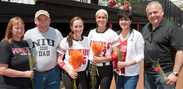 Seniors Bryanna Phelan (third from left) and Amanda Sheppard (third from right) celebrate with their parents.