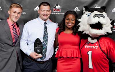 Dusty Page (men's soccer), Jason Schepler (football) and Sidra Sherrill (track and field) join Victor E. during the celebration.