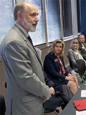 Baker speaks with Rockford-area leaders during his visit there May 23.