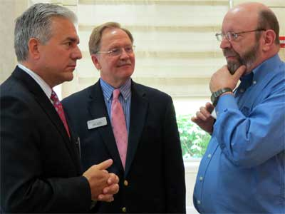 Scot Eberle, president of Fiberutilities Group, discusses broadband technology with Paul Borek, DCEDC executive director, and David Juday of IDEAL Industries.