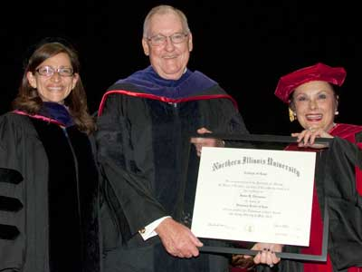 NIU Law Dean Jennifer Rosato (left) and Cherilyn Murer ('78), chair of the NIU Board of Trustees, present Gov. James Thompson with an honorary Doctorate of Law degree during NIU Law's commencement ceremony. Thompson also was featured as the commencement speaker.