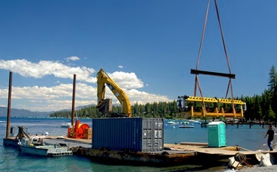 The robotic submarine is loaded onto the barge on Lake Tahoe.