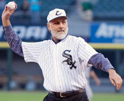 NIU president Doug Baker throws out the first pitch Wednesday, July 25, to Chris Sale prior to the White Sox game vs. the Detroit Tigers.