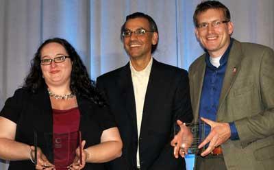 NIU's Stephanie Richter and Jason Rhode (right) accept awards alongside Jay Bhatt, president and CEO of Blackboard, Inc.