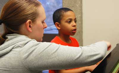 A young boy takes a piano lesson through the NIU Community School of the Arts.