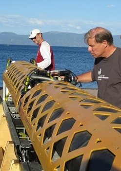NIU geologists Reed Scherer (left) and Ross Powell insect the robotic submarine.