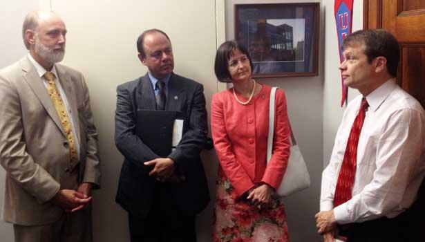 NIU President Doug Baker, Dean Promod Vohra and professor Lee Shumow speak with U.S. Rep. Mike Quigley.
