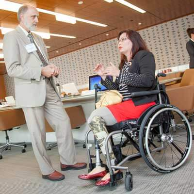 President Baker chats with Congresswoman Tammy Duckworth.