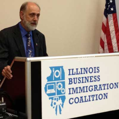 NIU President Doug Baker speaks Aug. 27 at a conference organized by the Illinois Business Immigration Coalition.