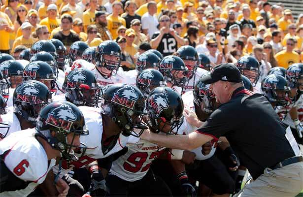 Coach Rod Carey revs up his NIU Huskies before they take the field against the Iowa Hawkeyes.