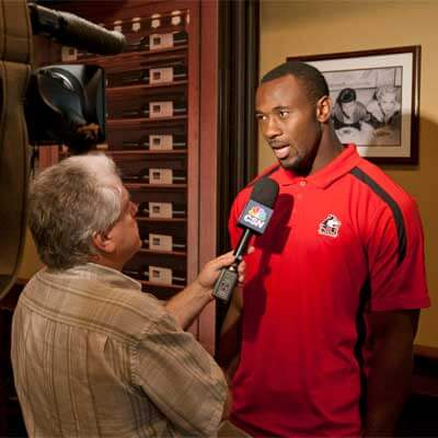 Defensive end George Rainey speaks to the media in Chicago.