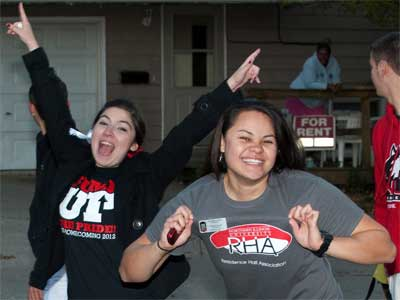 Students celebrate NIU during the 2012 Homecoming parade.
