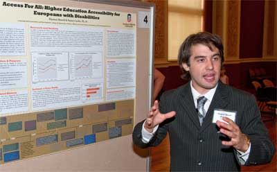 NIU history major Thomas Bouril, part of the Summer Research Opportunities Program, presents his research on access to higher education for Europeans with disabilities.