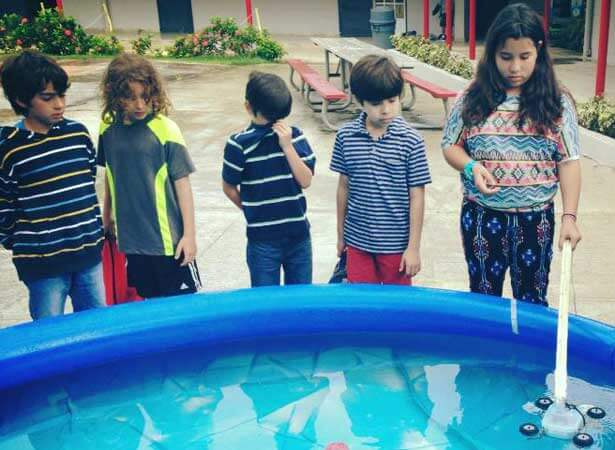 Children in Puerto Rico explored Waterbotics, a relatively new STEM field that creates underwater robotics, thanks to NIU mechanical engineering graduate student Pettee Guererro.