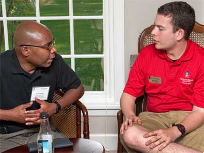 Weldy chats with Orientation Leader Eric Glasby.