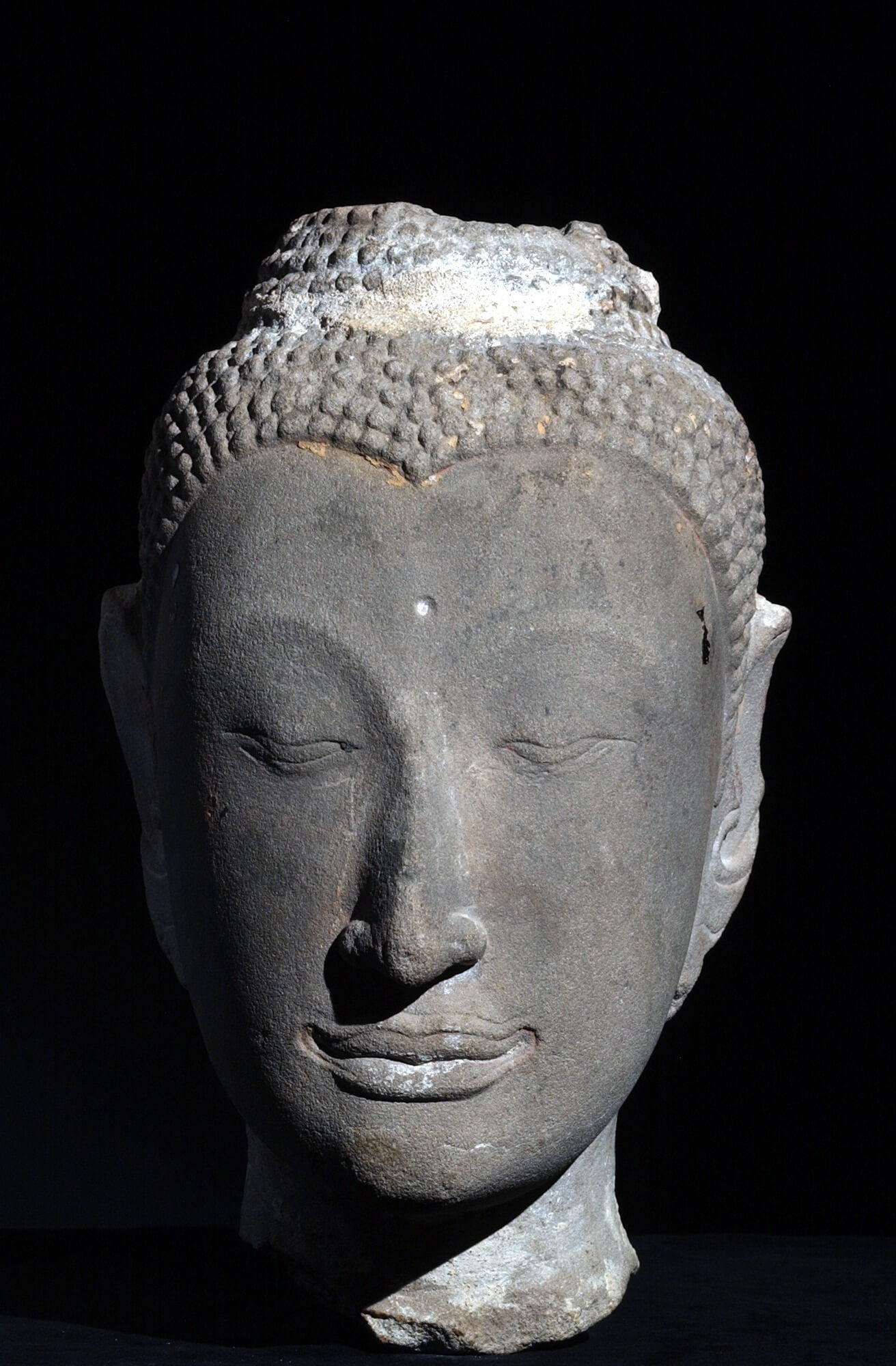 "This stone head from Thailand, dating from between the 16th and 17th centuries, will be on display for the first time in the ""Tai Cultures"" exhibit."
