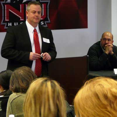 Bradley Bond, dean of the NIU Graduate School, speaks with students.