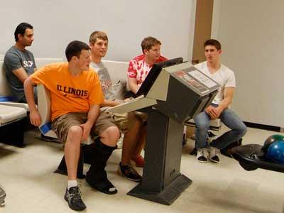 Students bowl in the Huskies Den.