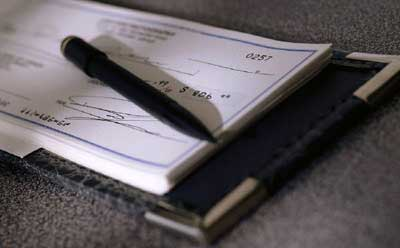 Photo of checkbook and pen