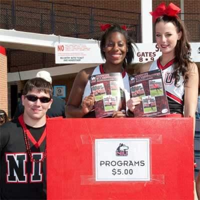 Huskie cheerleaders selling programs