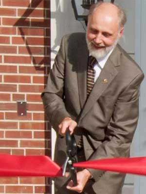 NIU President Doug Baker cuts the ribbon Thursday at Gilbert Hall.