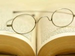Photo of reading glasses on an open book