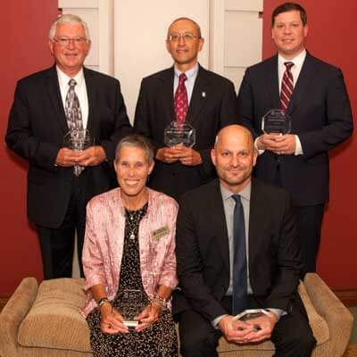Back, from left: James Alfini, Hon. Mark Lopez and Adam Vaught. Front, from left: Kate McCabe and Richard Lenkov.