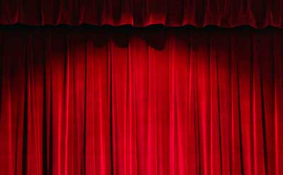 Photo of a red velvet curtain in a theater