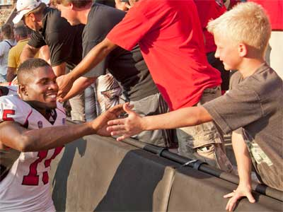 Jimmie Ward greets a young fan.