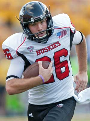 Tyler Wedel runs after pulling off a fake punt in Iowa City.