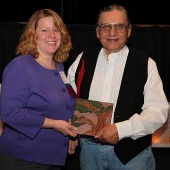 Carlos Velazquez receives the Rosa Parks and Grace Lee Boggs Outstanding Service Award in 2011.