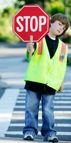 Photo of a young crossing guard with a stop sign