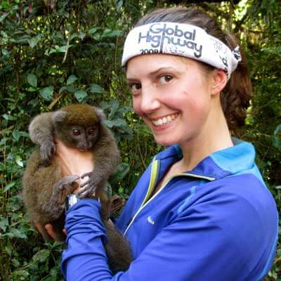Molly Fitzpatrick with a gray bamboo lemur.