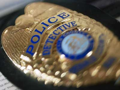 Photo of a police badge for a detective