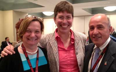 Lt. Gov. Sheila Simon is flanked by NIU's Anne Birberick and Jerry Montagat the Scaling Up conference in Bloomington, Ill.