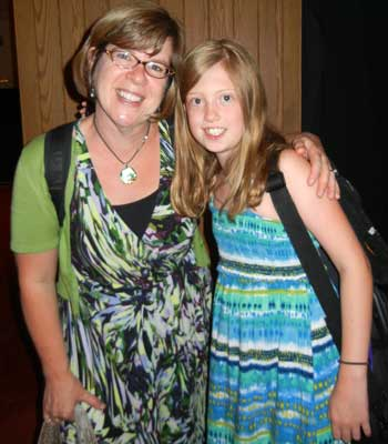 Erin Templin, daughter of Dan and Kristal Templin of Sycamore, was one of seven Suzuki violin students who received music scholarships recently from Vivian and John Spinoso. She is pictured with her violin teacher, Ann Montzka-Smelser.
