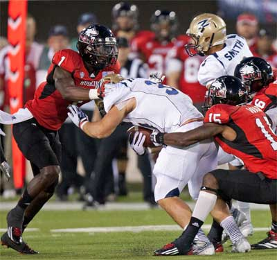 Dechane Durante and Jimmie Ward combine for a tackle.