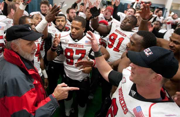 NIU President Doug Baker congratulates Jordan Lynch and the NIU Huskies after a 35-17 victory in Toledo.