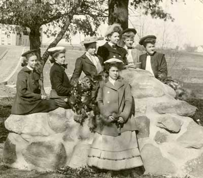 "Students pose around ""Freshman Bench,"" constructed in 1903."
