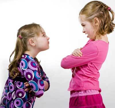 Photo of two young girls arguing