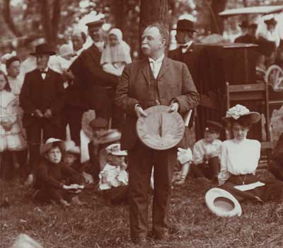 First NIU President John Williston Cook visits Freshman Class Day in 1905.