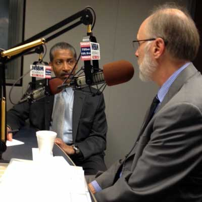NIU President Doug Baker tapes an interview Friday morning with Craig Dellimore, political editor of WBBM-AM radio.