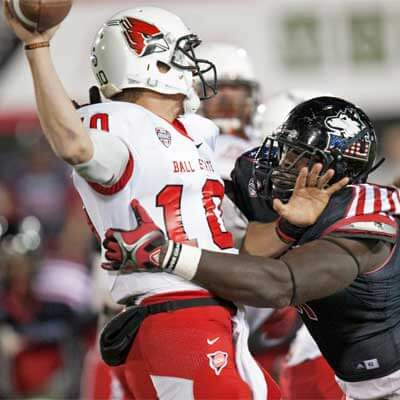 Anthony Wells pressures Ball State QB Keith Wenning.