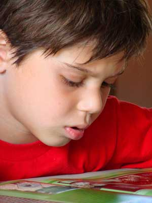 Photo of a boy reading a book