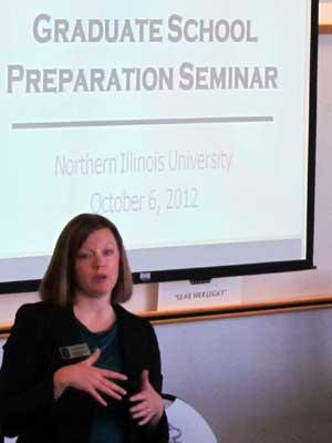 Julia Spears speaks with prospective graduate students.